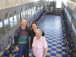 Derek and Catherine Hayward with farm owner Paddy Lockett (right) in the new parallel milking parlour.