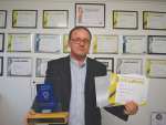 Ginelli's managing director Max Tairi with his awards.