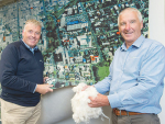 Palle Petersen of Bloch and Behrens (left) and general manager of PGG Wrightson Wool Grant Edwards inspect an Ege printed carpet taken from a photograph of the pre-quake Christchurch CBD.