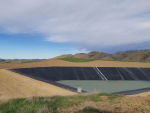 A recently constructed dam, to supply water to a vineyard in Marlborough, in the process of being filled. Photo Simcox Construction.