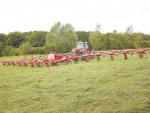 Kuhn's new high output grass tedder.