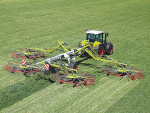 20 years of four-rotor swathers