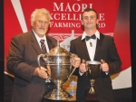 Rakaia Inc chairman James Russell (left) with the Ahuwhenua Trophy and Jack Raharihi, the Young Maori Dairy Farmer of the Year.