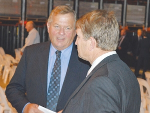 Colin Armer (left) with Fonterra director Malcolm Bailey at last year's annual meeting.