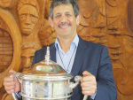 Kingi Smiler with the Ahuwhenua Trophy.