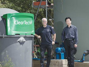 Professors Keith Cameron and Hong Di with the Lincoln University Dairy Farm ClearTech Effluent Treatment System.