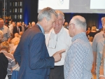 Former Fonterra directors Greg Gent (left), Harry Bayliss (centre), and Earl Rattray discuss matters at the annual meeting.