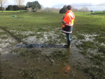 Waikato Regional Council officer inspecting extent of over application of effluent.