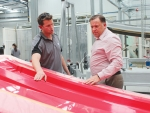 Waikato Milking Systems chief executive Dean Bell (right) and boatbuilder Josh Janmaat.