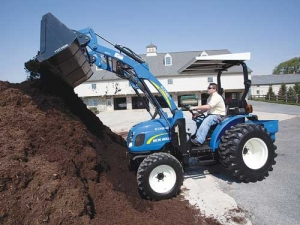 The New Holland Boomer comes with accessories like frontloaders.