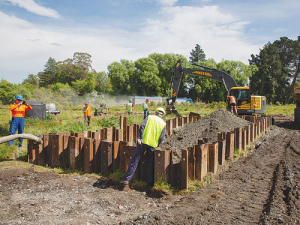 Construction of the denitrification wall at Silverstream Reserve using a mixture of woodchip and gravel