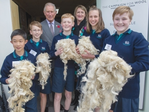 Prince Charles, Campaign for Wool NZ chair Phillipa Wright and children from Tawa Intermediate discover the qualities of wool.