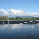 Effluent pond with stirrer