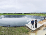 Tainui Group Holdings primary industries manager Mark Jackways (left) and Tainui Road Dairy manager Greg Boswell and an effluent storage pond on the farm.