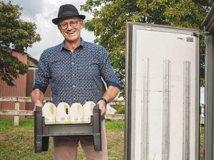 John Vosper loading Jersey Girl organic milk into the truck for delivery. Photo: Life and Leisure