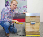 Berywn Hoyt of Brush Technology and Hivemind, with the beehive monitoring hardware at the company's Christchurch office.