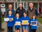 Chris Bascand (back-left), Hatuma's Nigel Wilson and farmer Hamish Thorne with students holding some of the new resources.