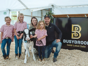 Busy Brook Hosteins' Nathan and Amanda Bayne with daughters Brooke, Sophia and Lily-Grace with calf, Busy Brook Doorman Hailstorm.