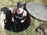 The founder of the NZ Farming Facebook page and instigator of its volunteer relief effort, Tyler Fifield, in a well on a farm near Kaikoura. The volunteers were trying to deepen the well by hand shovels after it dried up.