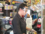 A supermarket worker wearing a face shield by Metalform.