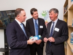 Prime Minister John Key looks at packaging with Chris Morgan (Tetra Pak Market Area Leader NZ) and Tim High (Tetra Pak Vice President) at the opening of the Tetra Pak office at Waikato Innovation Park, Hamilton, Thursday 7 April 2016. Photo: Stephen Barker/Barker Photography.