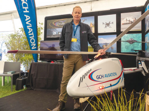 GCH Aviation's Drone Operations manager Rob Duff with the large gas turbine drone the company is trialling for a range of applications including agriculture. Photo: Rural News Group