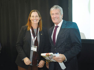 Katie Milne with Agriculture Minister Damien O'Connor at the Feds conference.