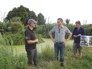 Climate Change Minister James Shaw  (centre) with farmer Aiden Bichan (left) at Kaiwaiwai Farm Wetlands, Featherston.
