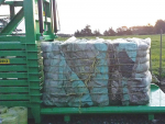 Agpac's plastic baler in action.