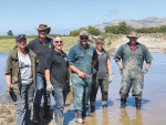 Federated Farmers executives led by president Katie Milne (left) help clean up affected farms.