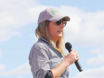 Chief executive of Pouarua Farms, Jenna Smith addresses the field day crowd.
