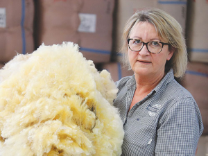 Philippa Wright with some this year's long, yellow wool.