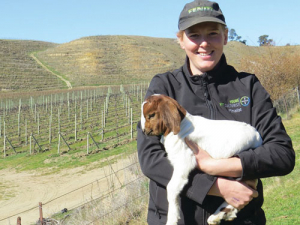 Back at Felton Road Annabel Bulk cuddles a boer goat kid raised on the property's scrubland block.