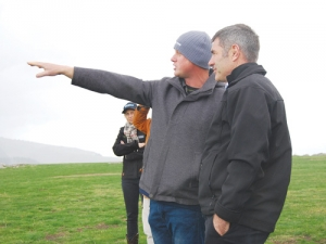 Omihi farmer Nick Hamilton points out the extent of drought damage on his property to Primary Industries Minister Nathan Guy.