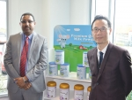 Evergrande Dairy general manager Yu Wei Ming and GMP Dairy's deputy general manager Ravi Kumaran.