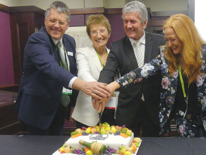 Hort leaders (from left) Horticulture NZ chairman Julian Raine, Primary ITO chief executive Linda Sissons, Agriculture Minister Damien O'Connor and NZ Avocado chief Jen Scoular representing the Horticulture Capability Group, cut the cake at the official launch of a new horticulture apprenticeship scheme.
