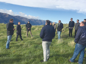 Jonathan Wallis of Minaret Station (left) shows an international group of chefs and food writers around his Alliance-supplying farm near Queenstown.