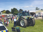 Police tractor ploughs on
