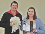 Goughs Bay sheep farmers George and Emma Masefield with wool and beauty products containing Keraplast keratin.